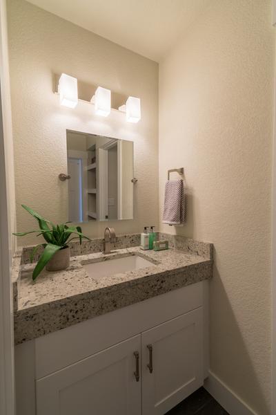 bathroom sink and vanity with lights of beach house remodel by Bellingham home builders