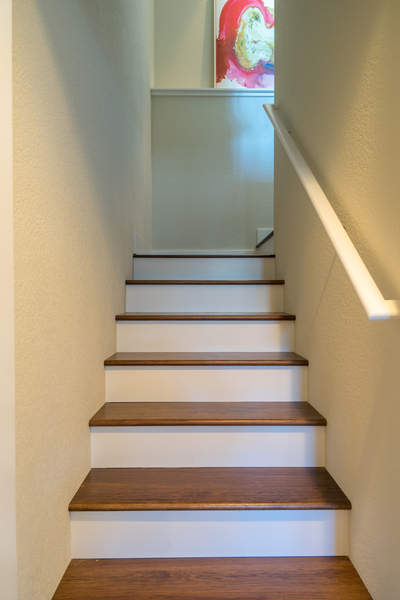 stairway of custom beach house remodel by Bellingham home builders