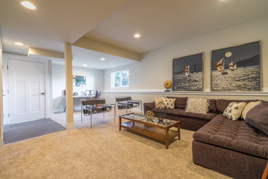 family room of beach house remodel with recessed lighting and natural light, furnished