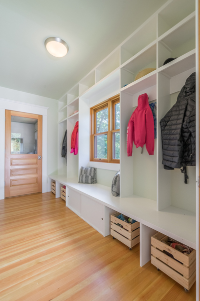 custom wall cubbies and open shelving in modern mud room