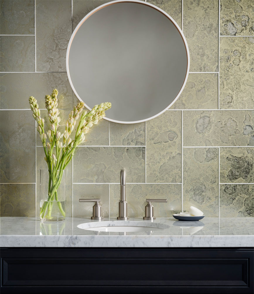 Oceanside glass tile antiqued mirror glass tile. Green tile backsplash in a residential bathroom