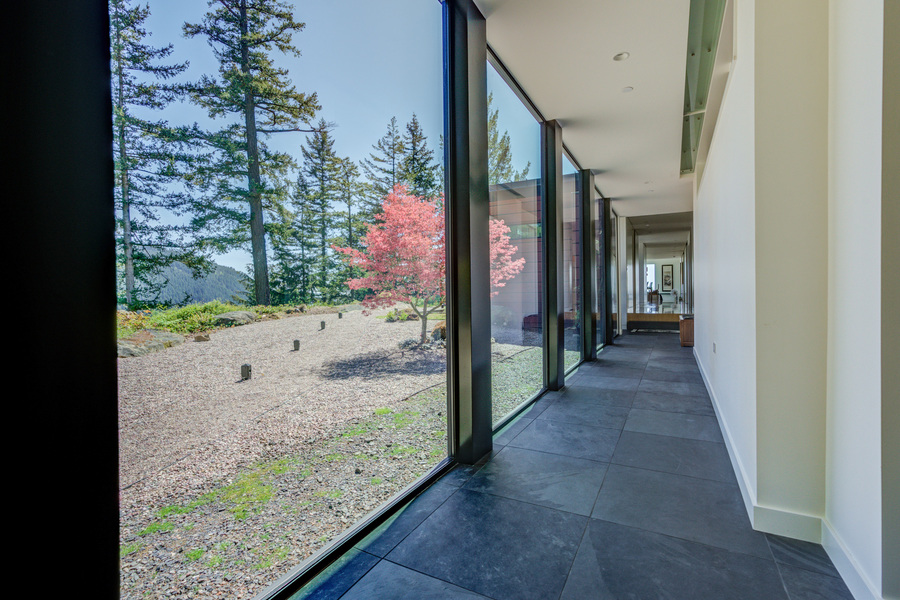 custom hallway with floor to ceiling windows showing mountain view