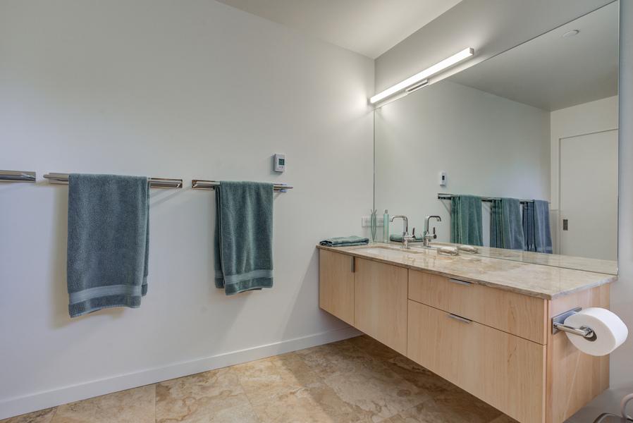 spacious bathroom design with raised countertop