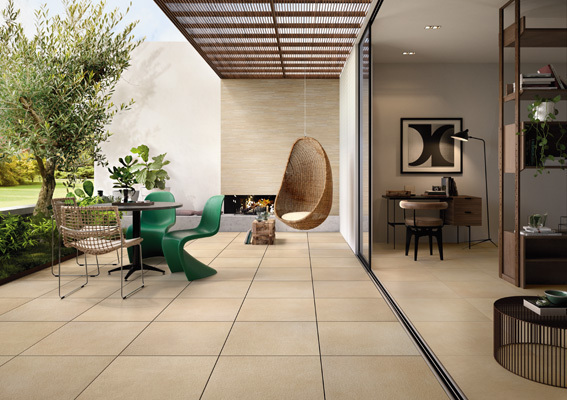 Bernina outdoor tile shown inside and outdoor. Beige square tiles interior and exterior design