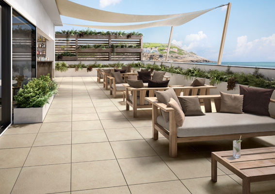 outdoor patio tiles from villeroy and boch Hudson collection. Shown in a restaurant rooftop bar with cozy outdoor furniture.