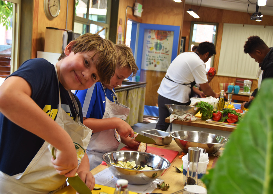 GPS kitchen interior featuring youth preparing food.