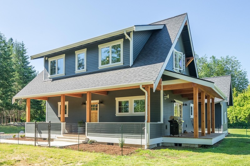 Bellingham home with wrap-around porch and tall open gable roof