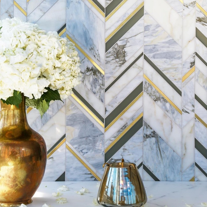 an updated chevron tile look. With marble, stone, and brass inlay this design can be changed to your own pick of materials to create a custom backsplash or accent tile