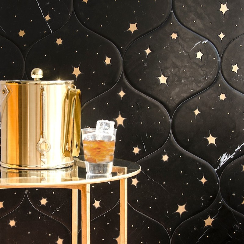 Constellation inspired stone and brass mosaic. Brass inlay stars in a waterjet mosaic from New Ravenna