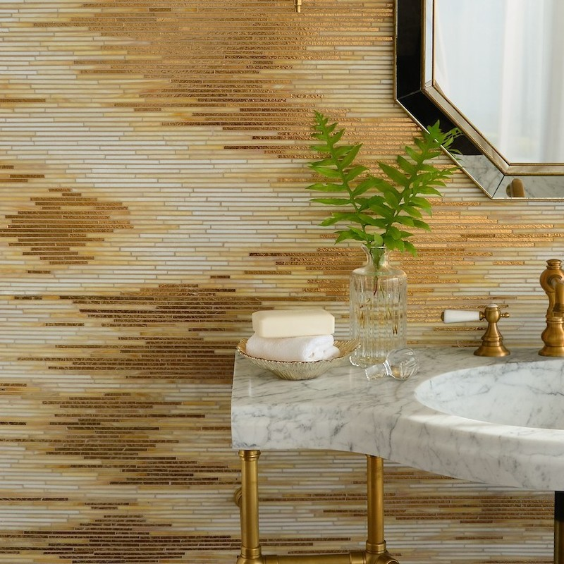 gold glass mosaic wall in a traditional bathroom. Made in the USA by artisans at New Ravenna this luxurious gold tile bathroom wall makes a big statement