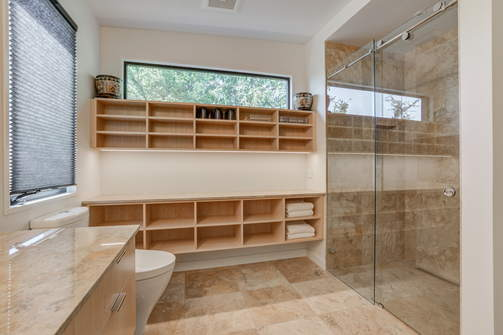 Custom designed bathroom with open wall shelves and luxury shower
