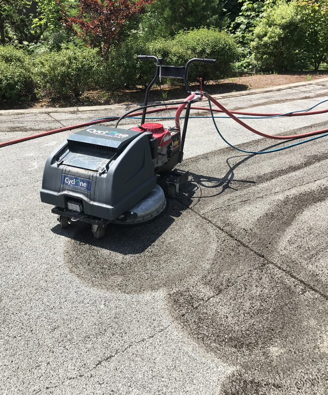 The Cyclone push behind Pervious Asphalt cleaning