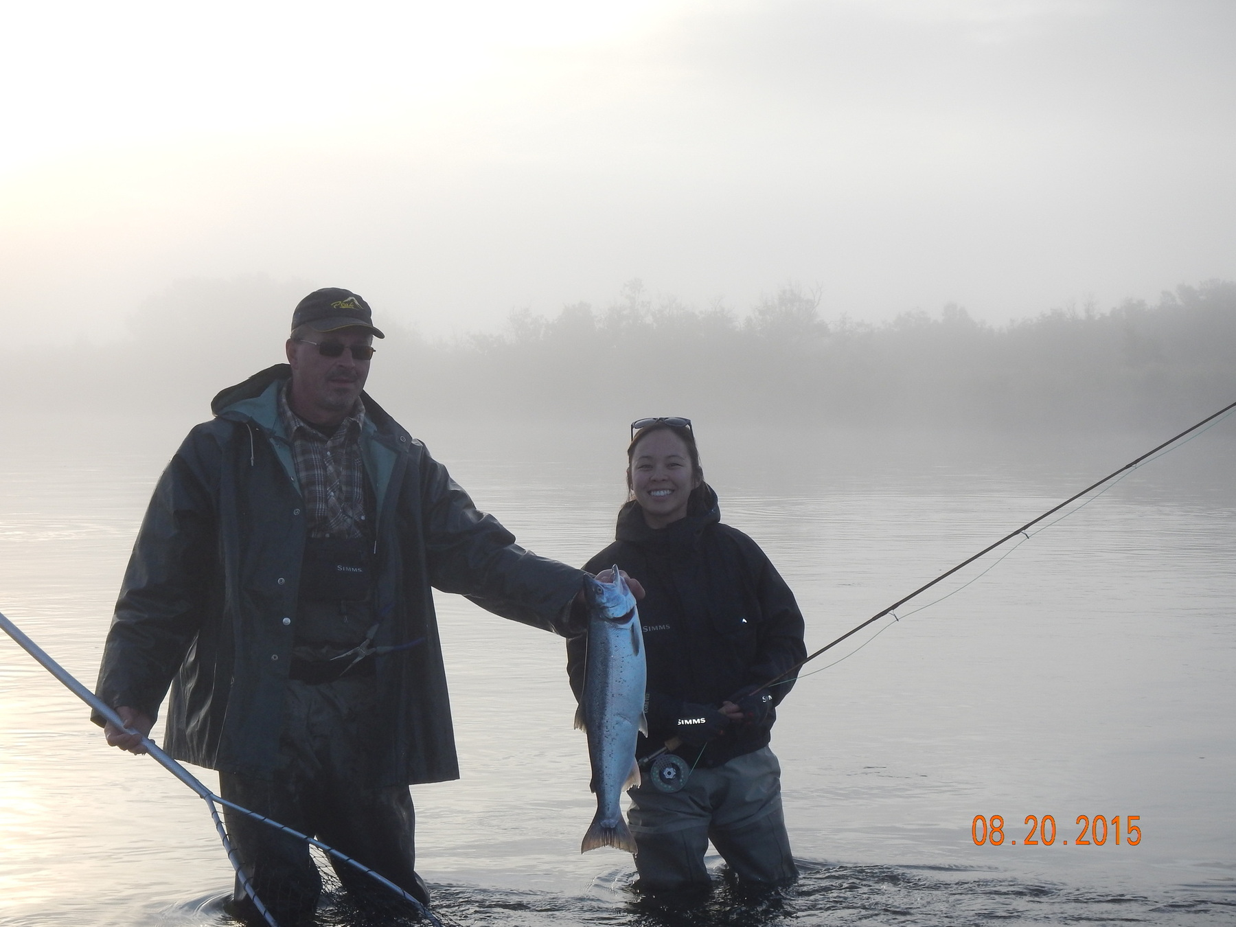 guide & client in river with fog