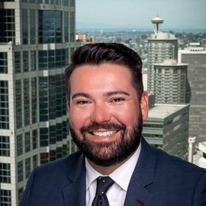 A portrait of board secretary Craig Pacheco