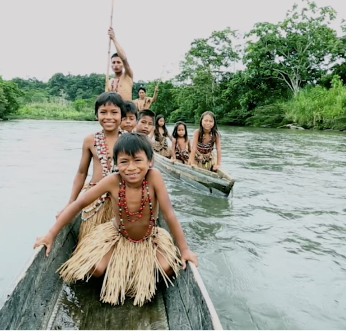 Children in a canoe-type boat on a river