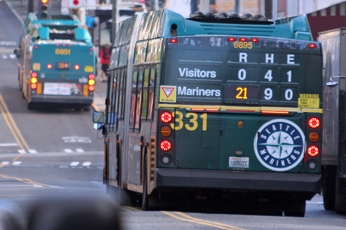 Back of a bus altered to look like a baseball scoreboard where the Mariners always win