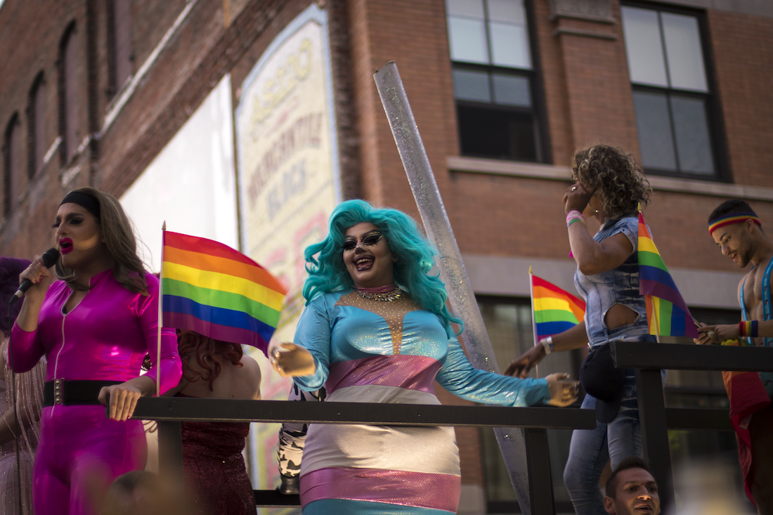 People celebrating Pride with rainbow flags