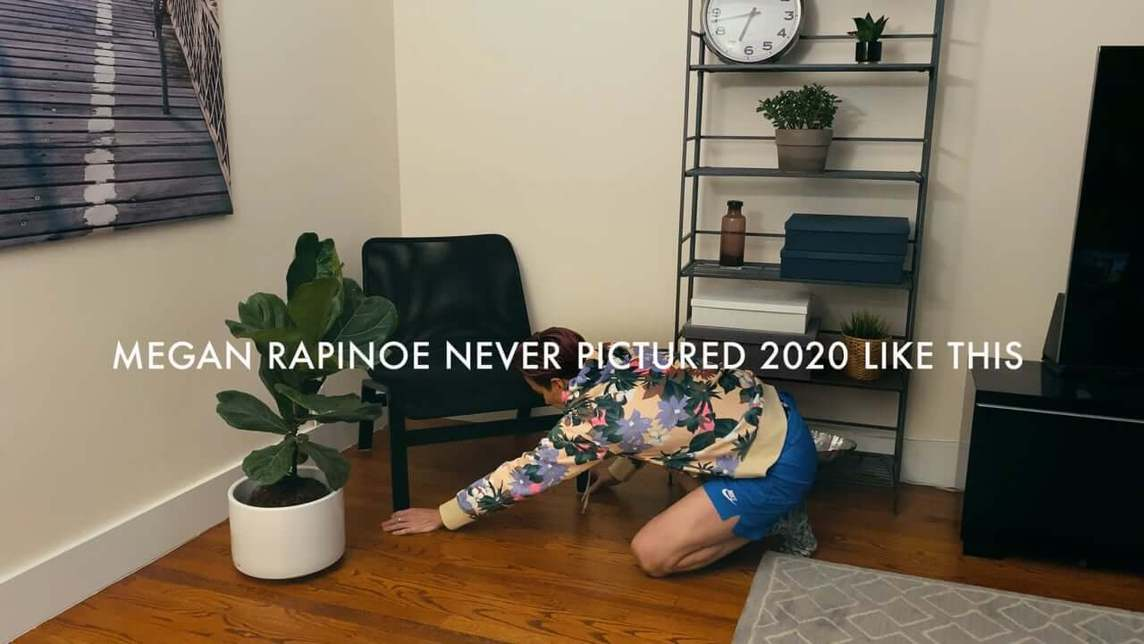 Megan Rapinoe adjusting the position of a chair in her home