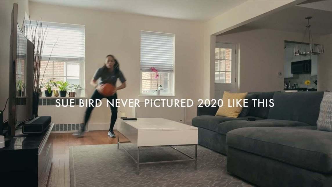WNBA star Sue Bird practicing basketball drills in her home