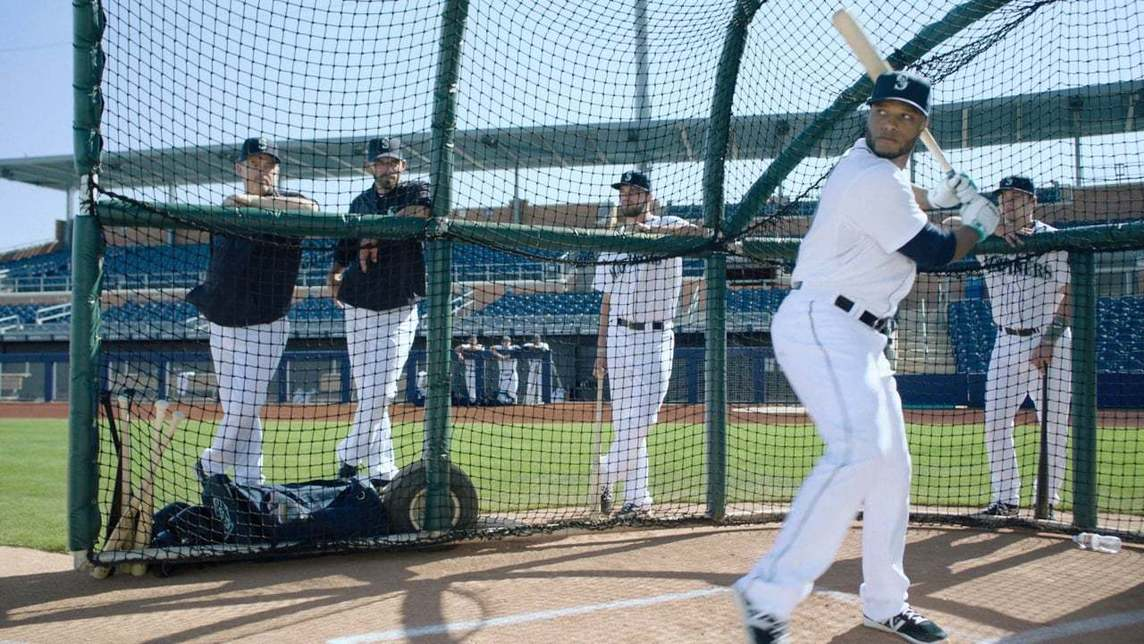 Seattle Mariners player at batting practice with team members onlooking