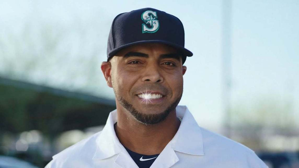 Seattle Mariners player Nelson Cruz smiling to camera with a gleaming tooth