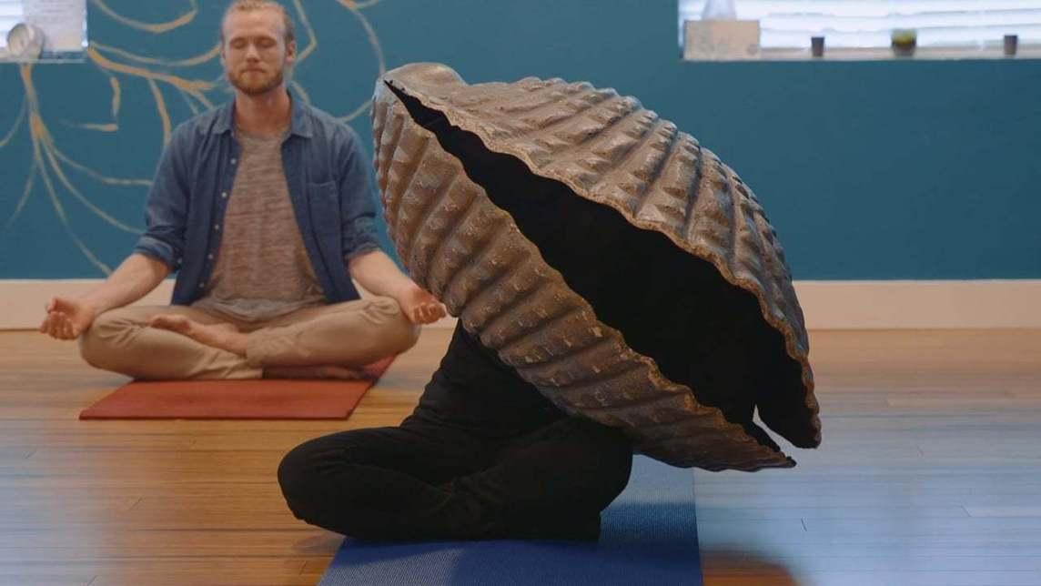 Person in a clam costume in a yoga class