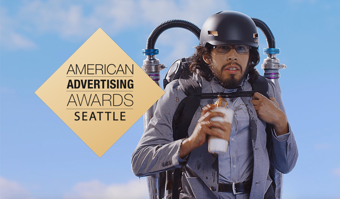 Man wearing a jet pack and holding coffee