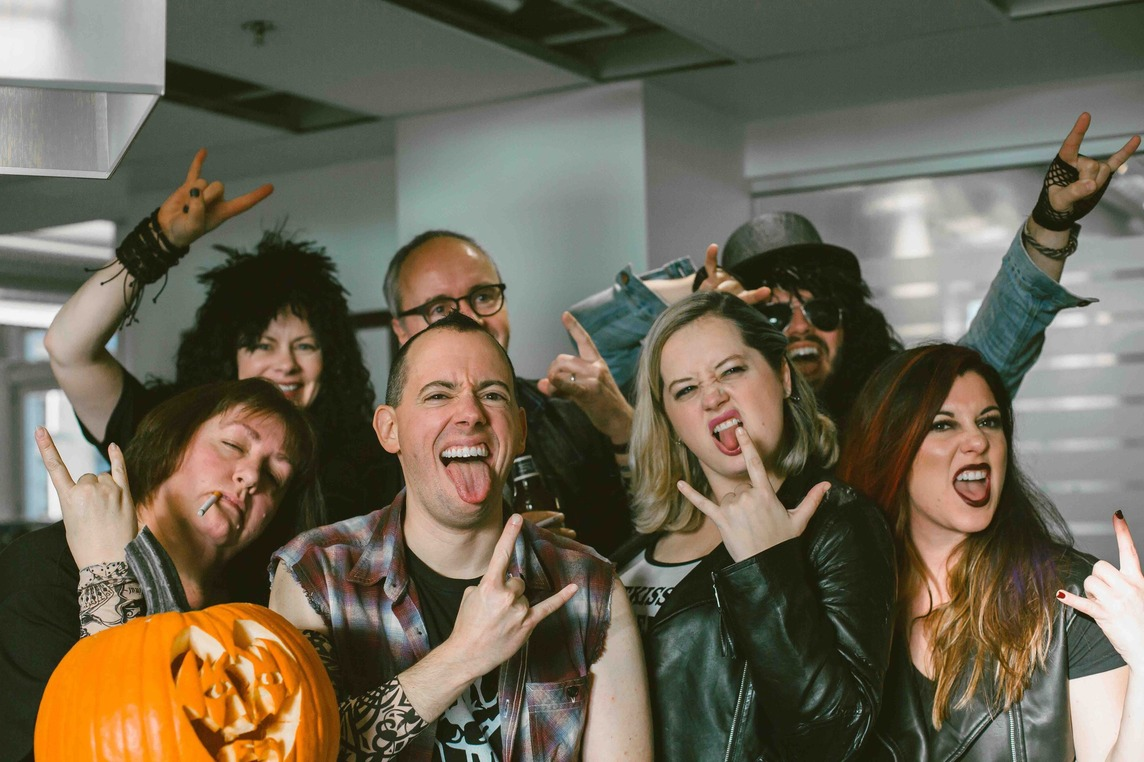 Office workers dressed as heavy metal fans for Halloween