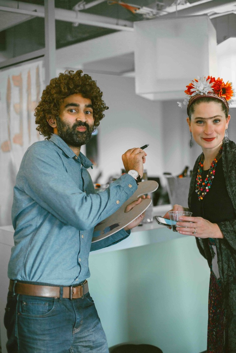 Office workers dressed as Bob Ross and Frida Kahlo for Halloween