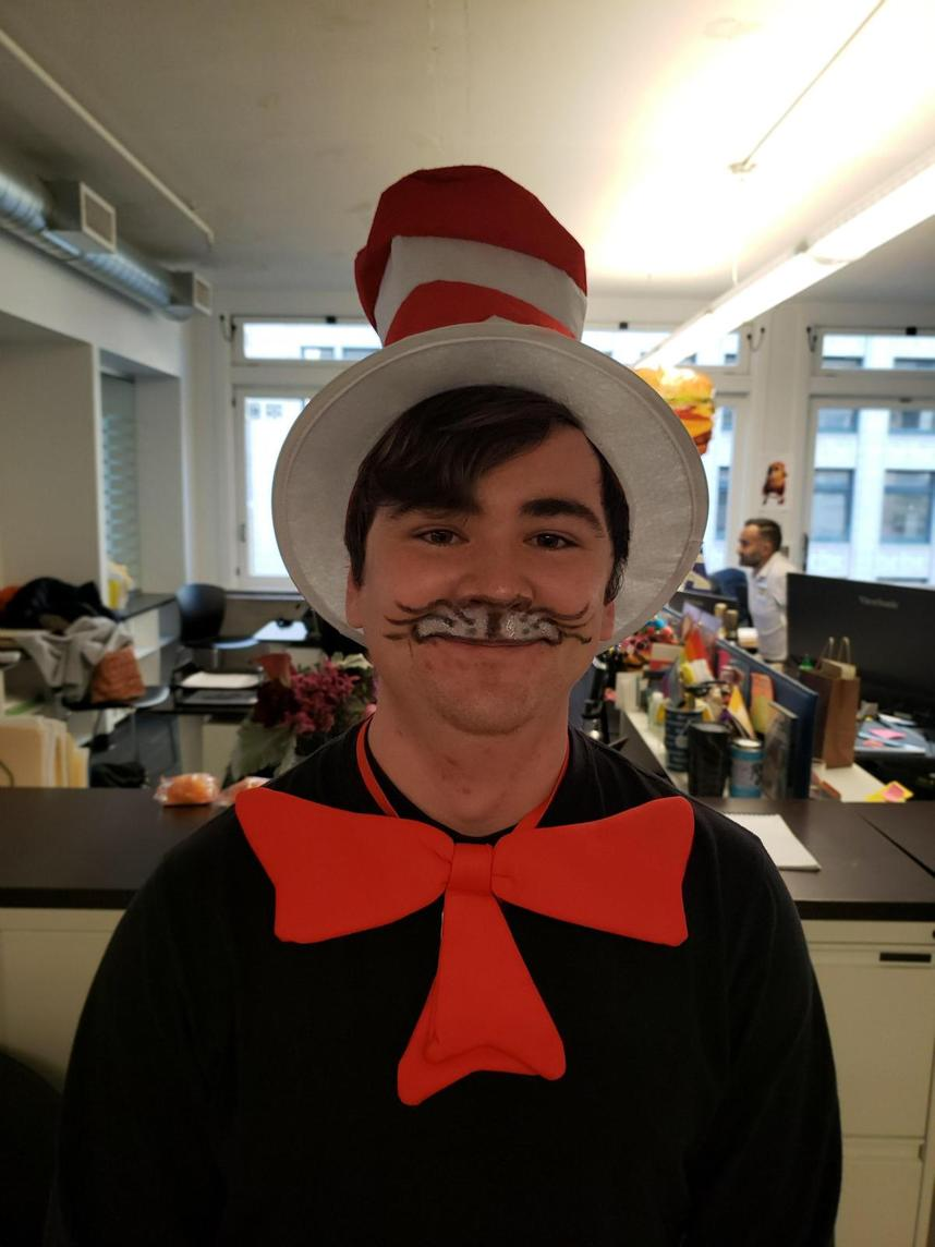 Man dressed at Cat in the Hat for Halloween