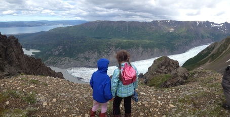 Two girls overlook a glacial lake in Alaska