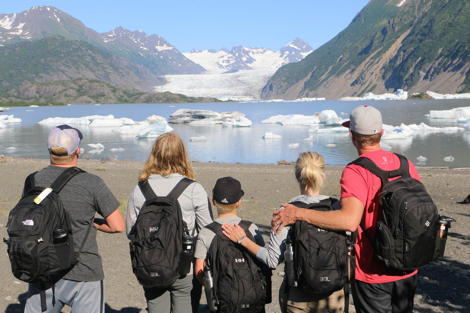 Family looking at icebergs in Alaska lake