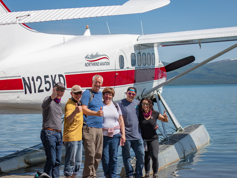 Group of bear viewers in front of a DHC3 Otter