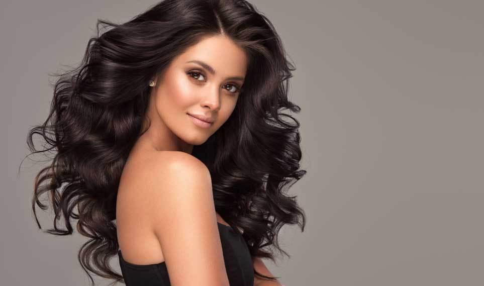 Beauty brunette girl with longand shiny wavy black hair in mill creek wa