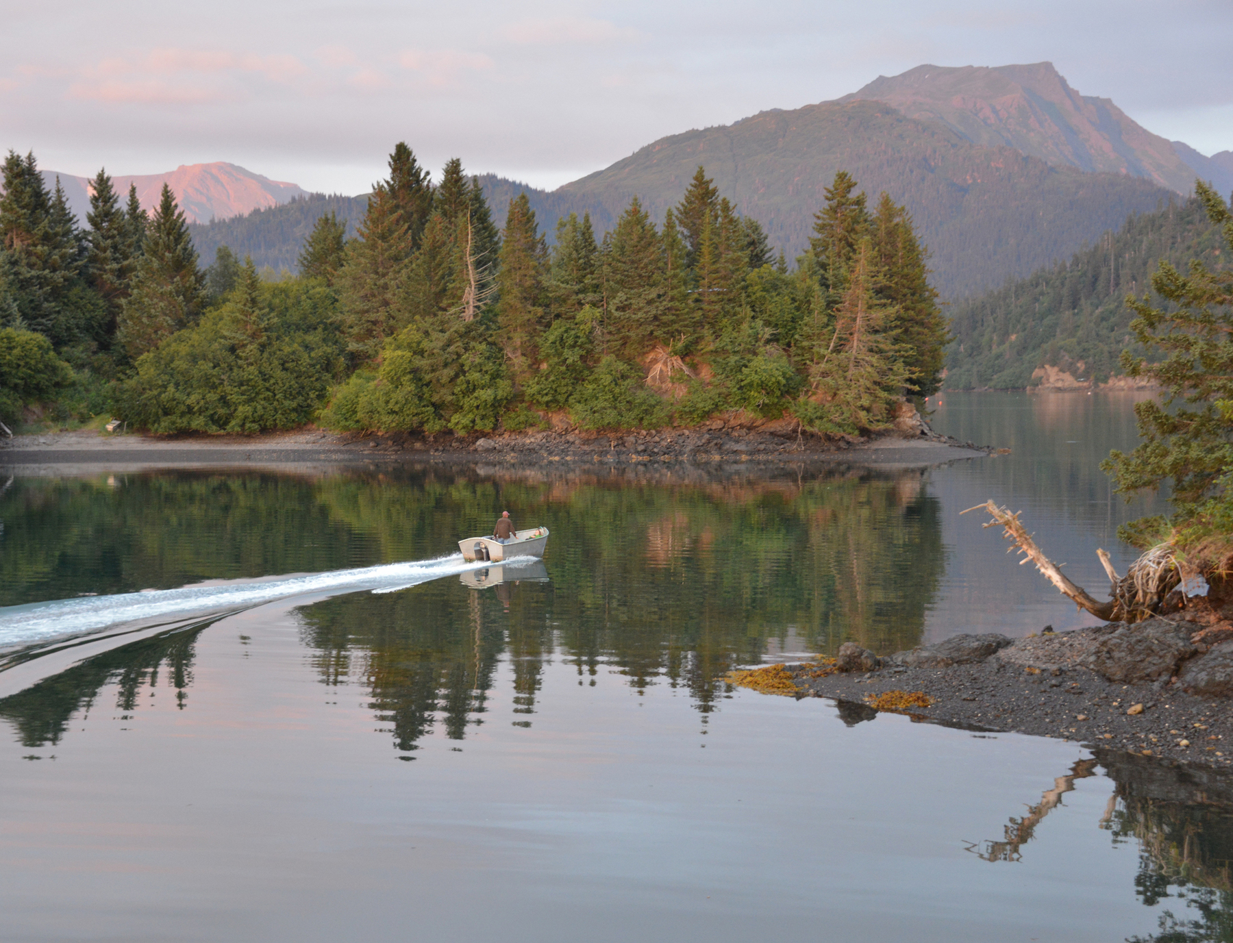 A boat glides across Alaska's Kachemak Bay