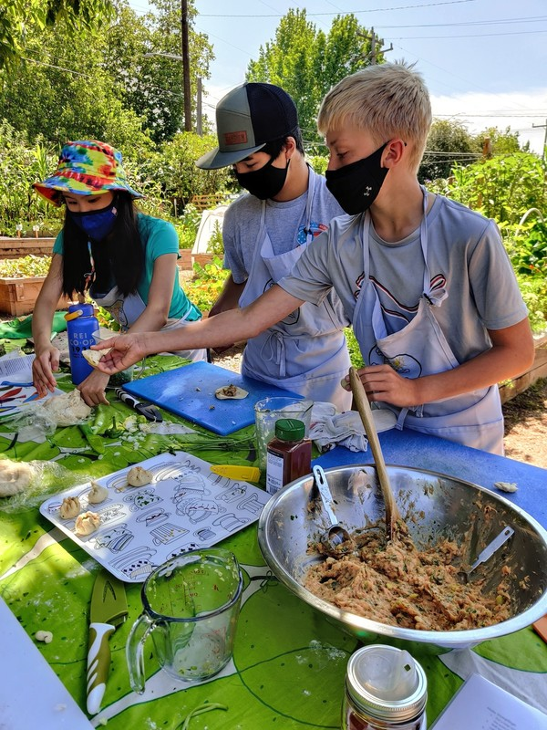 youth preparing dumplings