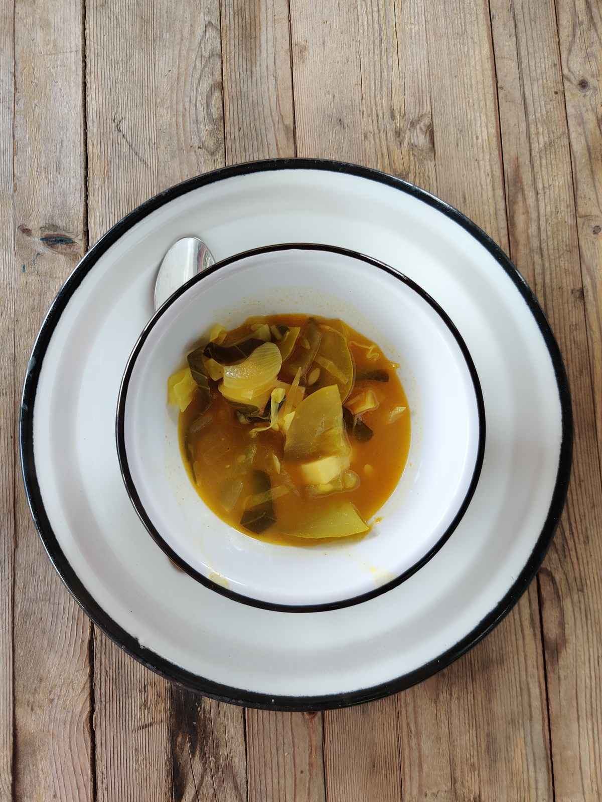 east african vegetable curry in a bowl on a plate.
