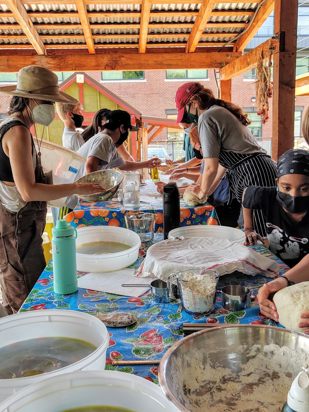a group making dumpling wrappers.