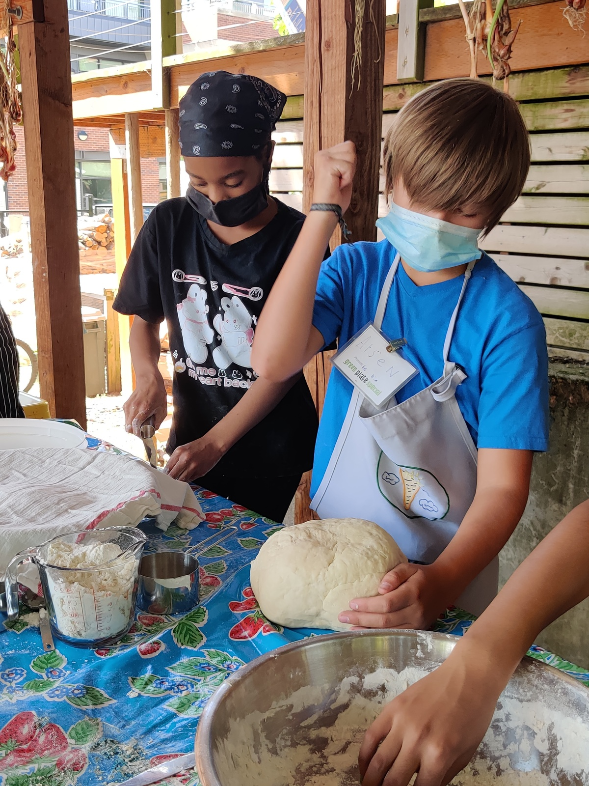 two youth making dumplings.