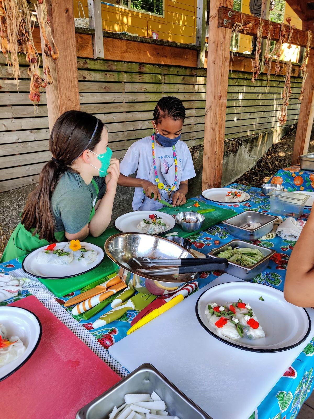 youth preparing fresh rolls.