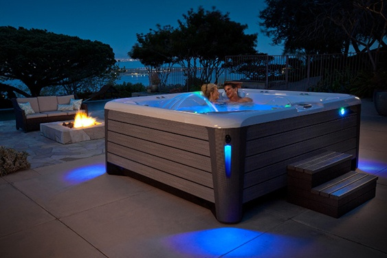 an image of a couple enjoying the ambiance of a beautiful evening and the gentle romantic lighting of a highlife grandee nxt jacuzzi