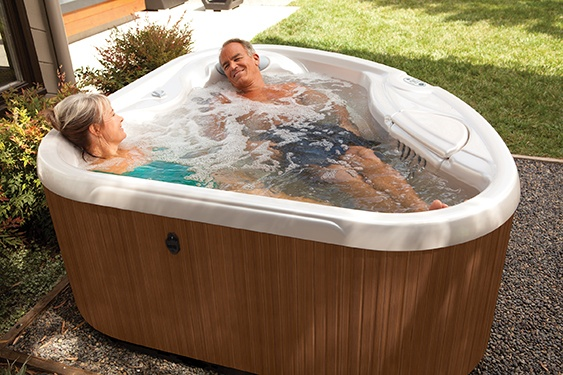 939ca9ae9f3 a couple enjoys a soak in a smaller energy efficient two person spa known  as the