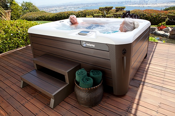 a couple relaxes in their super energy efficient Jetsetter hot tub