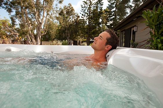 an image of a man relaxing in a hot tub to promote a better night's sleep