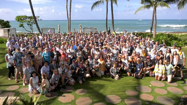Group Photograph of Watkins Wellness dealers and staff celebrating their success in the hot tub industry at the annual dealer incentive trip.