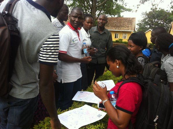 Douglas instructing students at UCU Mbale