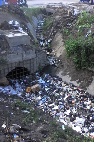 Dumping of solid waste in drains at Africa Sanaa along Shekilango Road PHOTO CREDIT: Ramani Huria