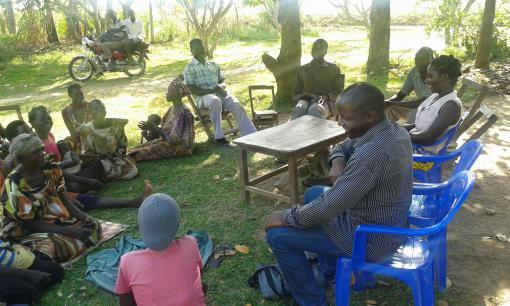 Attending a SACCO (local savings club) meeting in Uganda