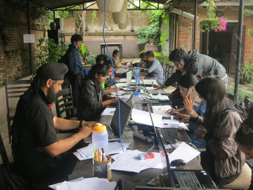 Volunteers working on collecting crowd-sourced information for quake response