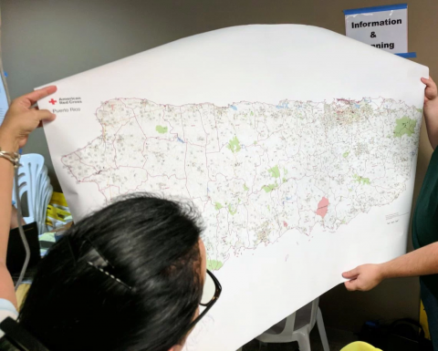 Red Cross volunteers present map made with OSM data